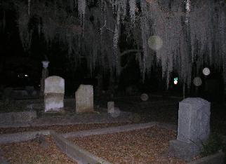 An eerie image of a grave yard at night