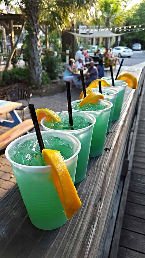 A row of cocktails on an outdoor bar