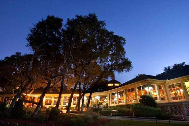 an exterior photo of the golf club at night