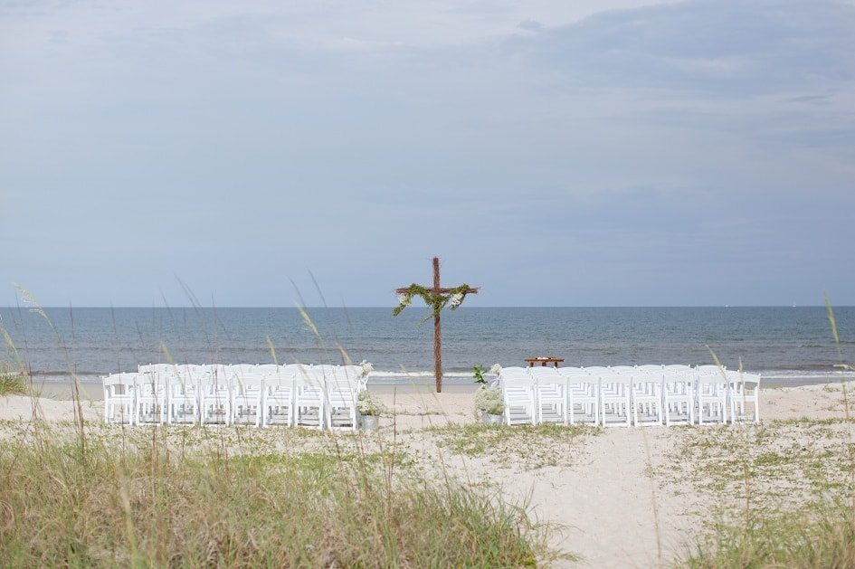 a wedding ceremony set up on the beach