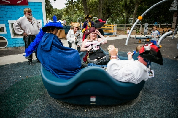 people riding on a playground ride