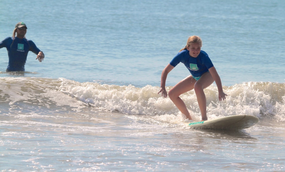 a girl surfing on a wave